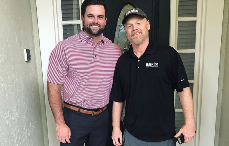 BiltRite Home Inspections team member posing with a satisfied client.