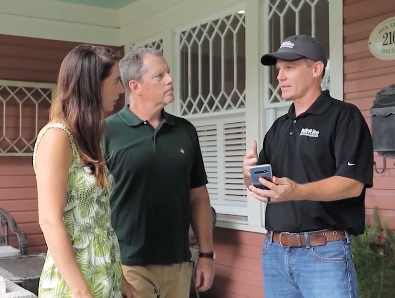 One of our home inspectors in Jacksonville, FL, talking with clients.